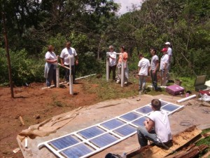 Volunteers from Virginia installed three 70- watt solar panels